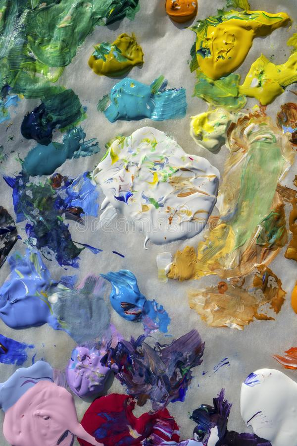 Artists acrylic paint palette close up semi abstract full frame stock photography