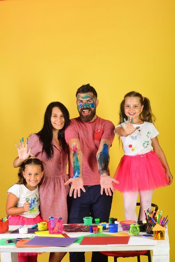 Artists create artwork on guys body. Family leisure time royalty free stock photos