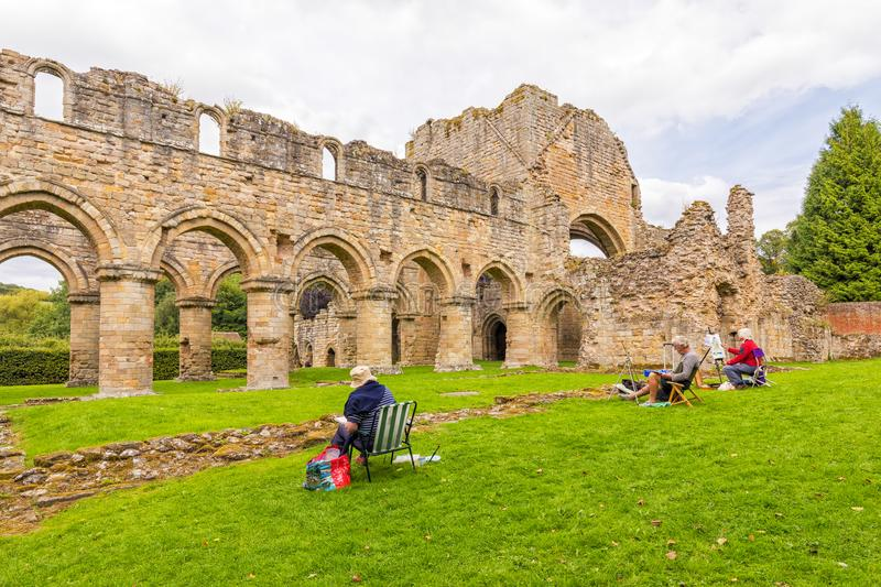 Artists Painting at Buildwas Abbey, Shropshire. stock photo