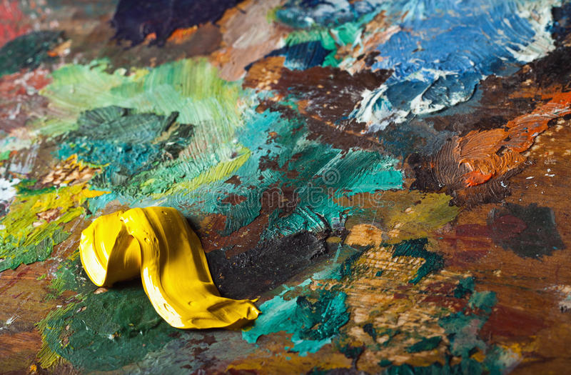 Artists palette with mixed oil paint stock photography