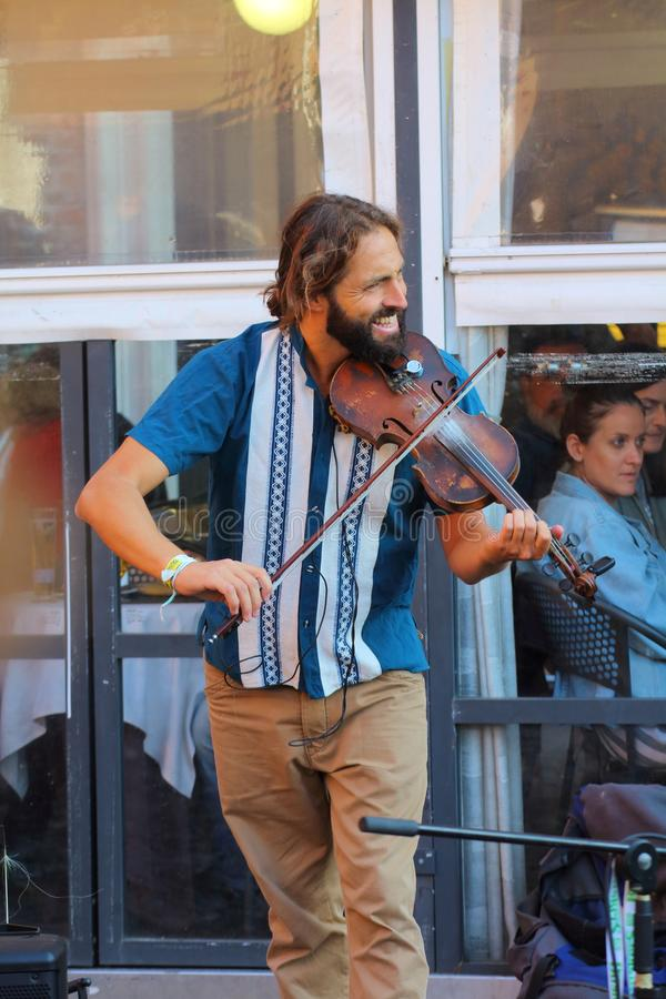 Artists perform in the street. Buskers Festival. Ferrara, Italia - August 26, 2018: The Ferrara Buskers Festival is dedicated to the art of the street. Artists stock image