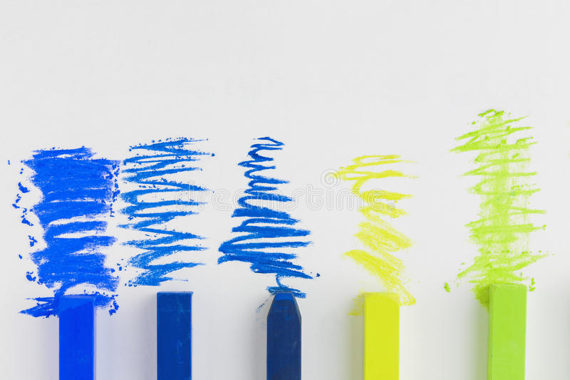 Artists soft pastels scribbles. Artists blue green and yellow soft pastels and scribbles on white background stock photography