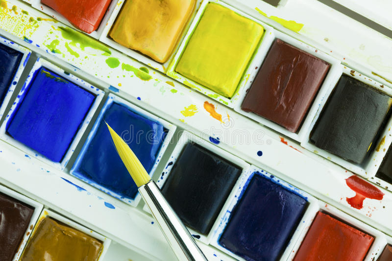 Artists watercolour paints and paint brush stock image
