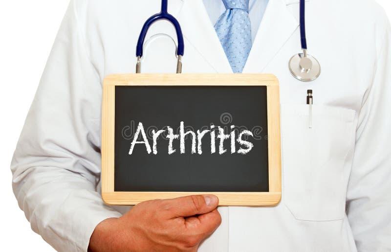 Artritis - doctor con la pizarra foto de archivo
