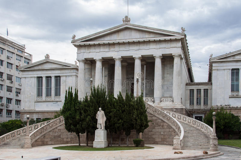 Arts Academy Athens Greece. The facade of the arts academy with two sculptures on top of columns and ionic columns on the facade. Athens, Greece royalty free stock photos