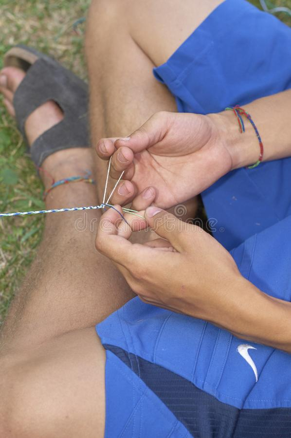 Arts & Crafts at Camp. Staff member making necklace at summer camp stock image