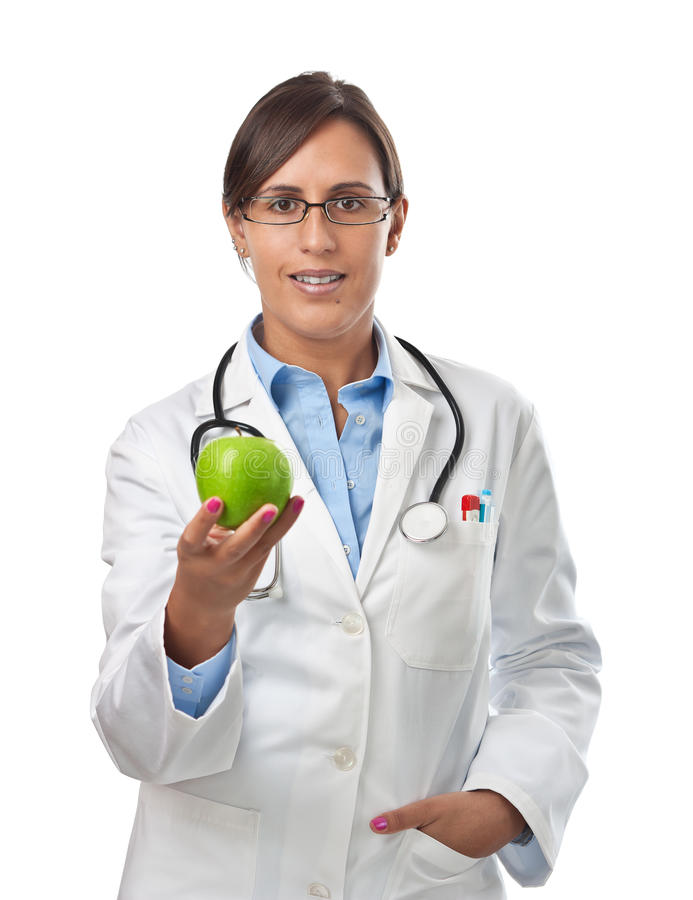 Arts die een appel geeft als gezond het eten voorbeeld stock afbeelding