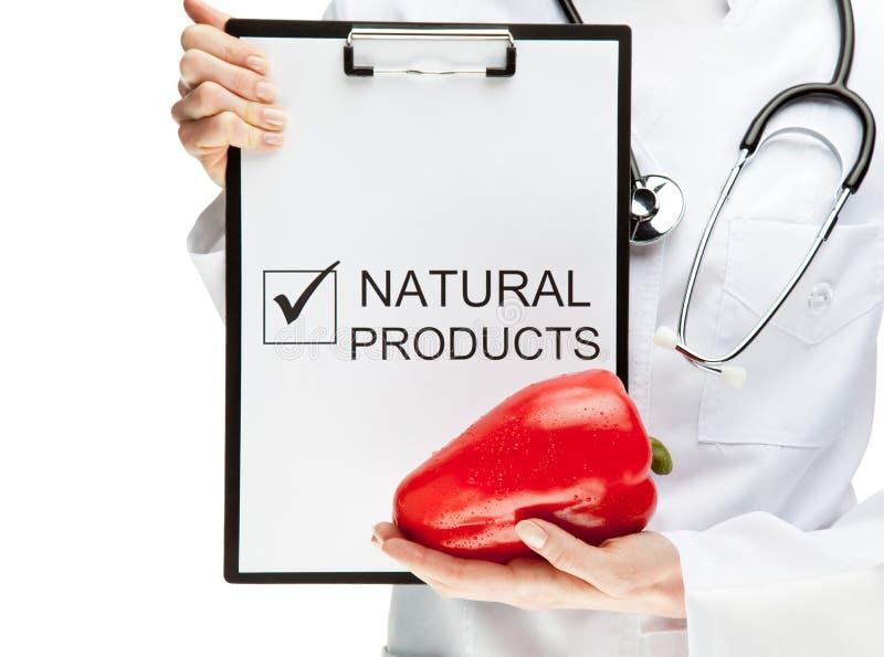 Arts die etend natuurvoeding adviseert stock afbeelding