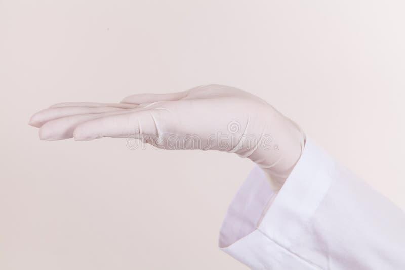 Arts Hand met Handschoen in positie stock fotografie