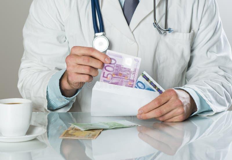 Arts met geld stock foto's