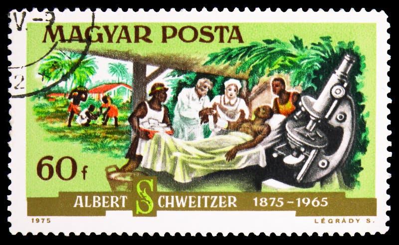 Arts Schweitzer en een patiënt, serie, circa 1975 stock afbeelding