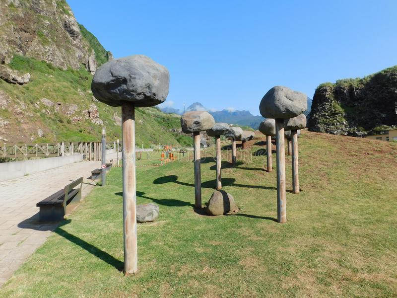 Arts with stones. Stones on sticks in a park in a country of europe exactly in Portugal royalty free stock photography