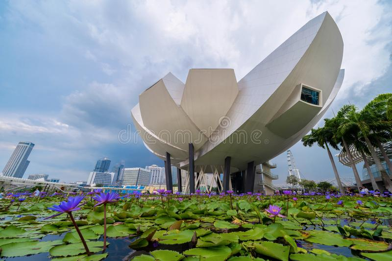 ArtScience Museum Singapore and lotus flowers in Downtown Singapore city in Bay area. Financial district and skyscraper buildings stock images