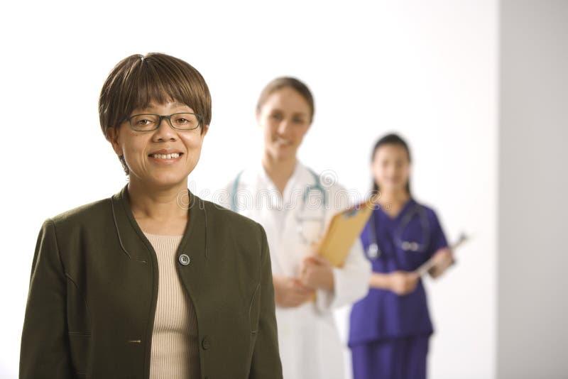 Artsen en patiënt. stock foto