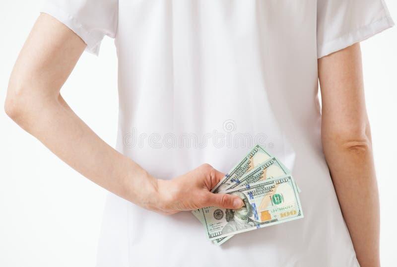 Artsen verbergend geld stock fotografie