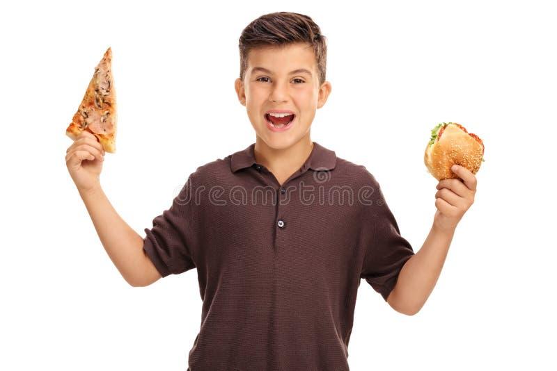 Żartuje trzymać kanapkę i plasterek pizza obraz stock