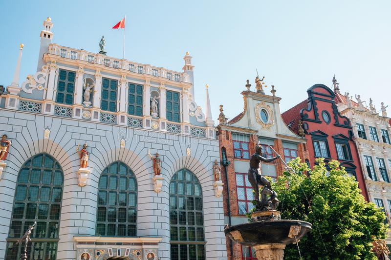 Artus Court and Neptune`s Fountain at Dlugi Targ Long Market street in Gdansk, Poland royalty free stock image