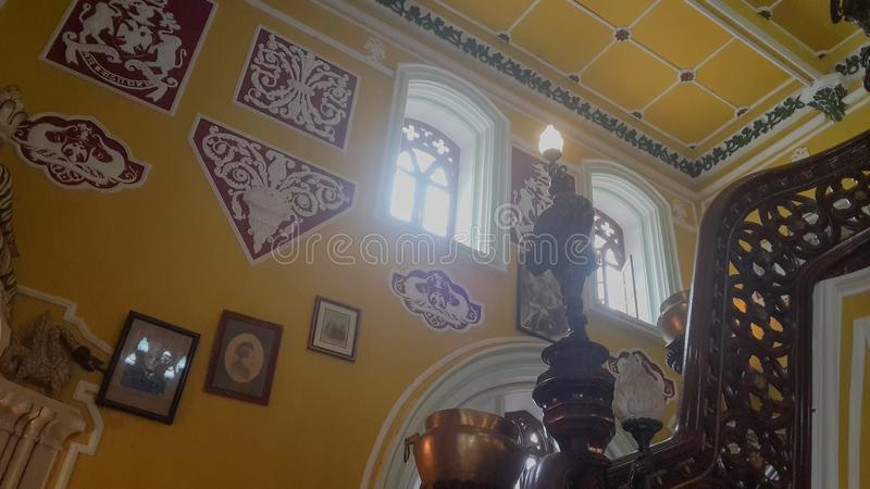 Artwork at Banglaore Palace, Bengaluru, India. BENGALURU, INDIA - FEBRUARY 20, 2017: Interior decoration of famous Bangalore Palace. It was private residence of royalty free stock photography