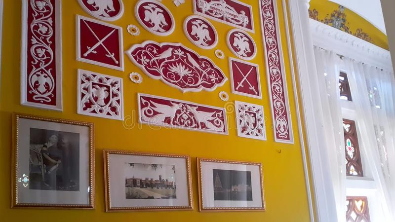 Artwork at Banglaore Palace, Bengaluru, India. BENGALURU, INDIA - FEBRUARY 20, 2017: Interior decoration of famous Bangalore Palace. It was private residence of stock photo