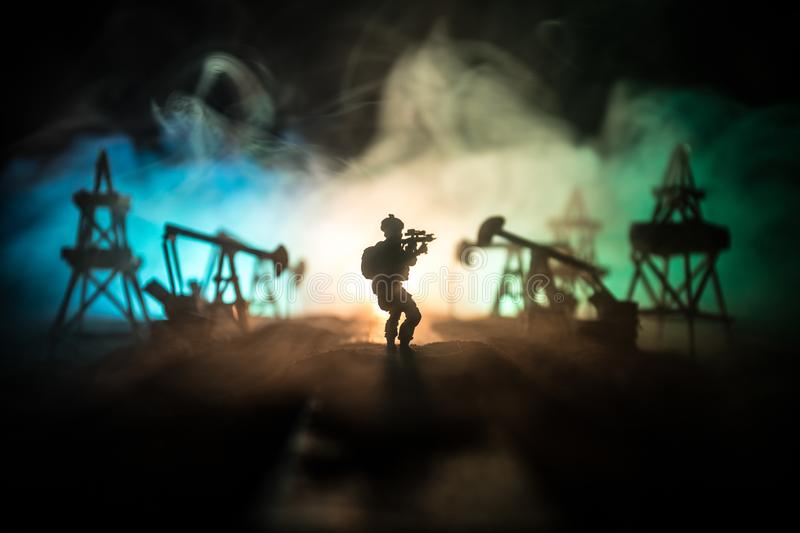 Silhouette of military soldier or officer with weapons. shot, holding gun, colorful sky, background. war and military concept. Artwork decoration. Oil war stock images
