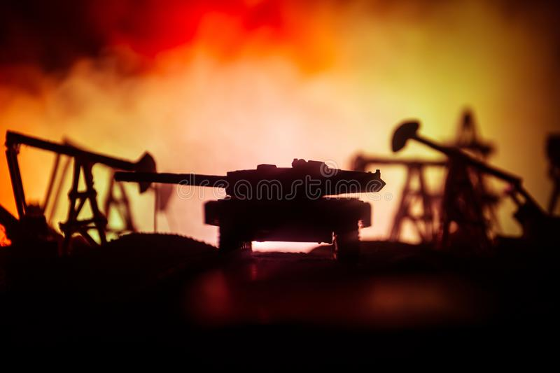 Silhouette of military soldier or officer with weapons. shot, holding gun, colorful sky, background. war and military concept. Artwork decoration. Oil war royalty free stock photo