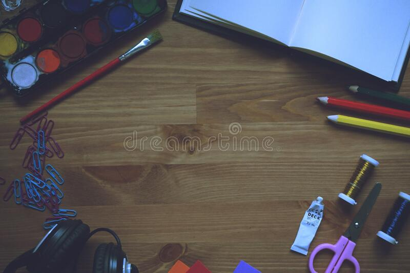 Artwork Materials on Wooden Table stock photo