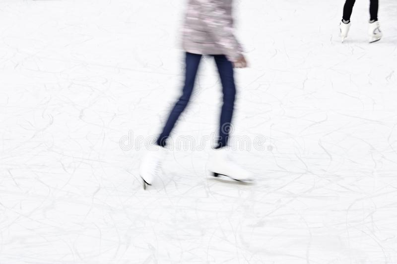 Arty blurry ice skating detail stock images