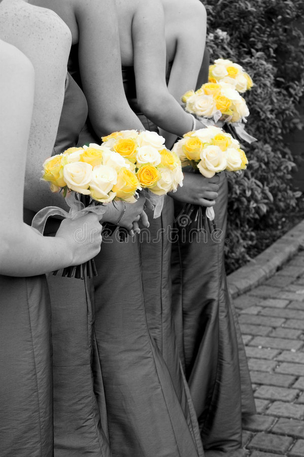 Arty Bridesmaids. Bridesmaids holding flowers at a wedding (black and white with colour popping royalty free stock photos