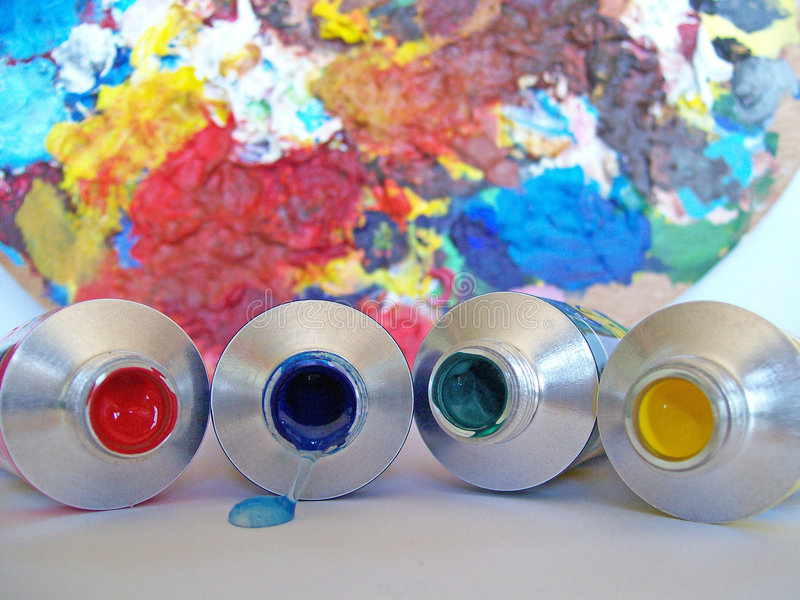 Arty 18. A selection of different coloured acrylic paints royalty free stock photography