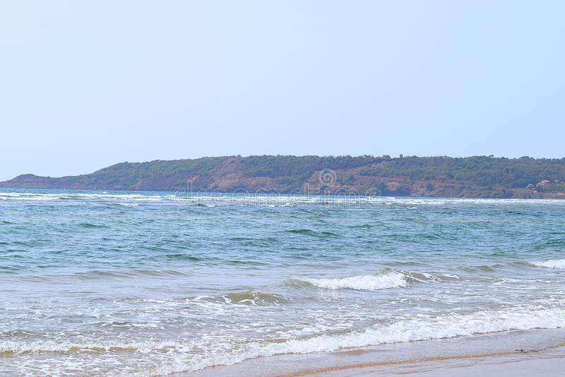Artykuły plaża - Spokojna i Nieskazitelna plaża w Ganpatipule, Ratnagiri, maharashtra, India fotografia royalty free