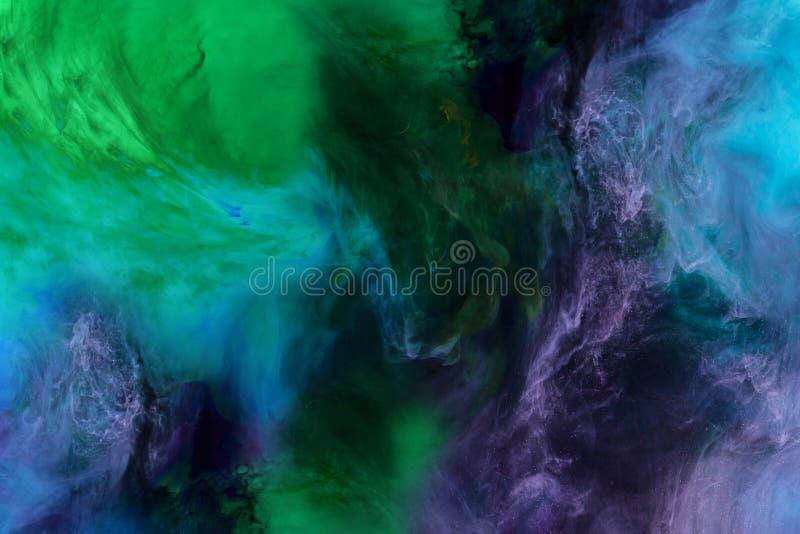artystyczna tekstura z błękitnej, purpur i zieleni farbą, wiruje spojrzenia jak przestrzeń zdjęcie royalty free