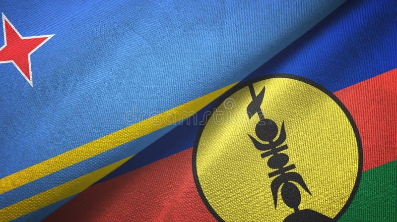 Aruba e Nova Caledónia: duas bandeiras, tecido têxtil, textura têxtil fotografia de stock