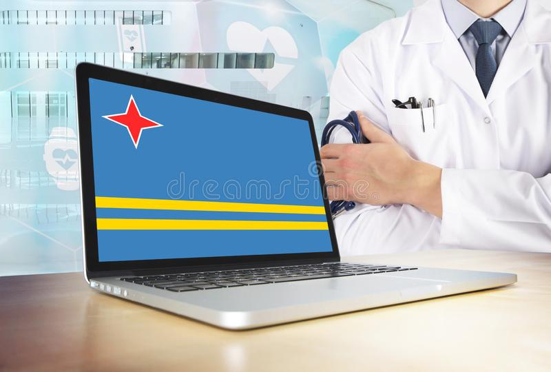Aruba healthcare system in tech theme. Flag on computer screen. Doctor standing with stethoscope in hospital. Cryptocurrency and. Blockchain concept stock image