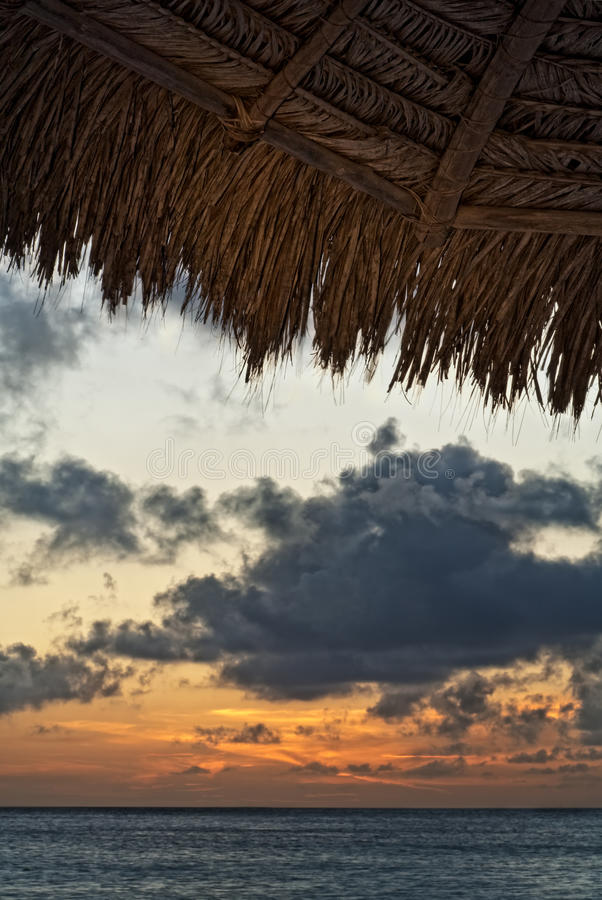 Download Aruba Sunset and Cabana stock photo. Image of roof, caribbean - 12850840
