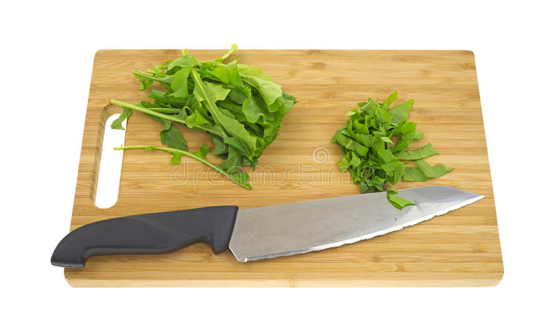 Download Arugula Herb On Cutting Board With Knife Stock Photo - Image: 24364110