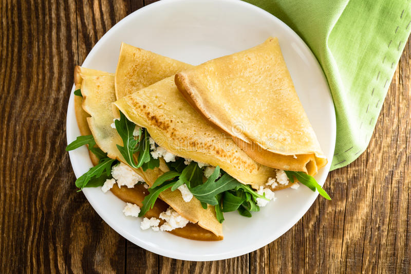 Arugula salad and cheese crepes. For healthy breakfast viewed from above royalty free stock image