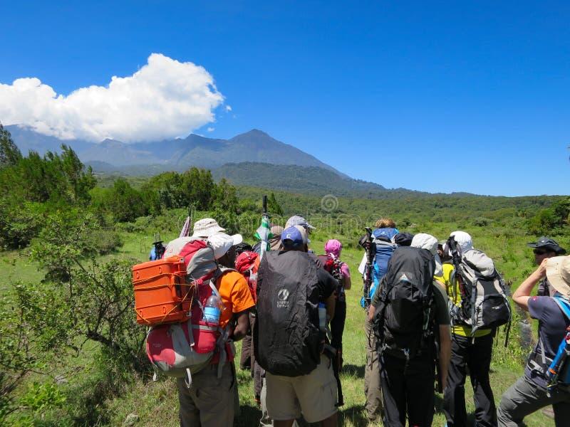Mountain guides and climbers prepare to start climbing Mount Meru in Arusha National Park in Tanzania. Arusha National Park, Kilimanjaro Province / Tanzania - 30 stock photography