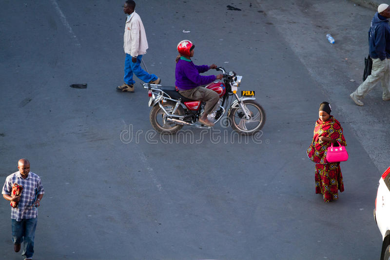 Arusha station. Arusha statiion people walking in the street of the town of arusha in tanzania stock image