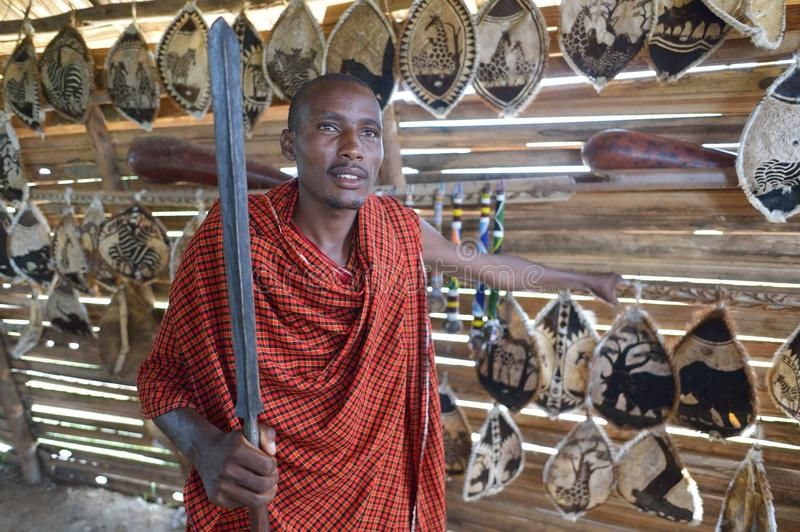 Arusha, Tanzania, February 07, 2016: Massai man in his traditional shop. Massai man in his shop in Africa royalty free stock photos
