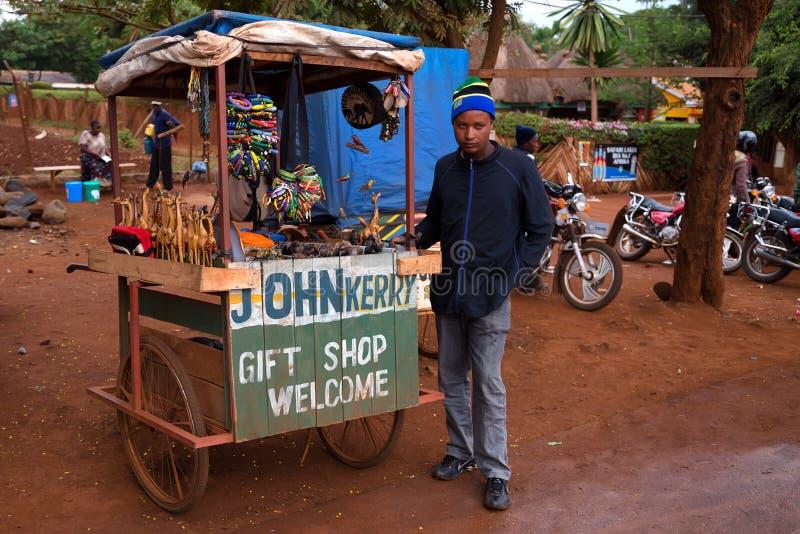 ARUSHA, TANZANIYA - CIRCA 2015: GIFT SHOP. ARUSHA, TANZANIYA - CIRCA 2015: SMALL OUTDOOR GIFT SHOP MENTIONING POLITICIANS AND A STREET VENDOR royalty free stock photography