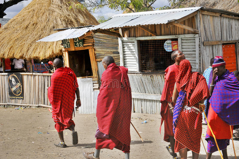 Arusha village. ARUSHA,TANZANIA-OCT 20: Unidentified Masai people walking through the Arusha village on Oct 20, Arusha, Tanzania. The Maasai are a Nilotic group stock photos