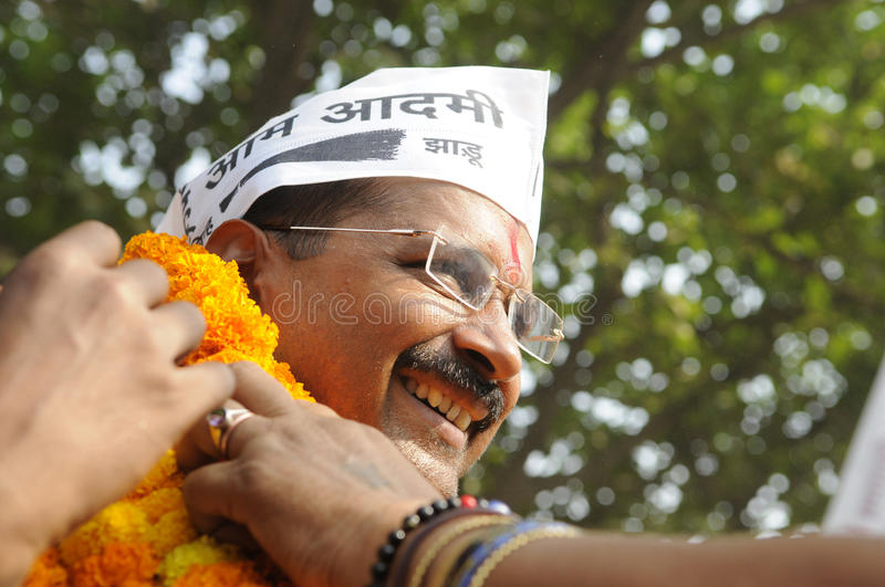 Arvind Kejriwal during an election rally in India. VARANASI - MAY 4 : Arvind kejriwal sharing a smile while being garlanded by his supporters during a road show stock photos