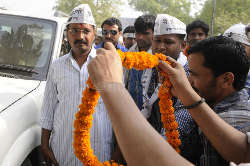 Arvind Kejriwal during an election rally in India. VARANASI - MAY 4 : Supporters waiting with garland while Arvind kejriwal is coming out of his car during a royalty free stock photography