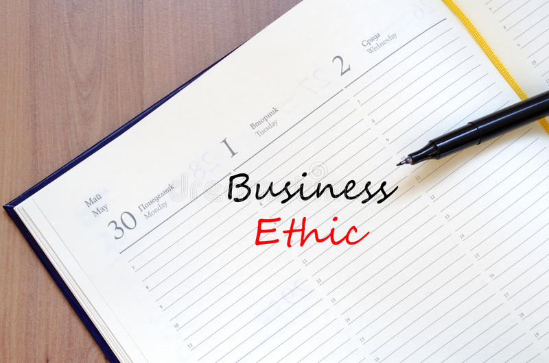 As éticas de negócio escrevem no caderno imagens de stock royalty free