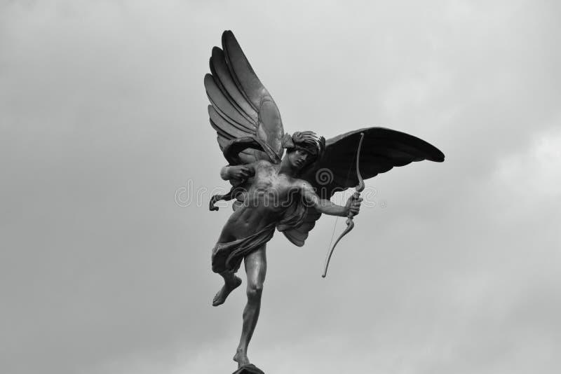 As asas, a curva e a seta fotografia de stock