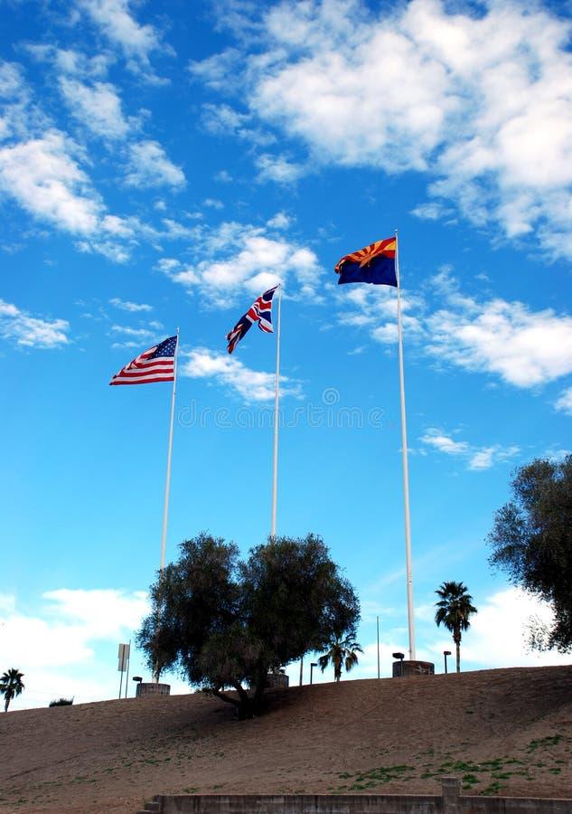 As bandeiras do Arizona, de Grâ Bretanha e dos EUA fotografia de stock