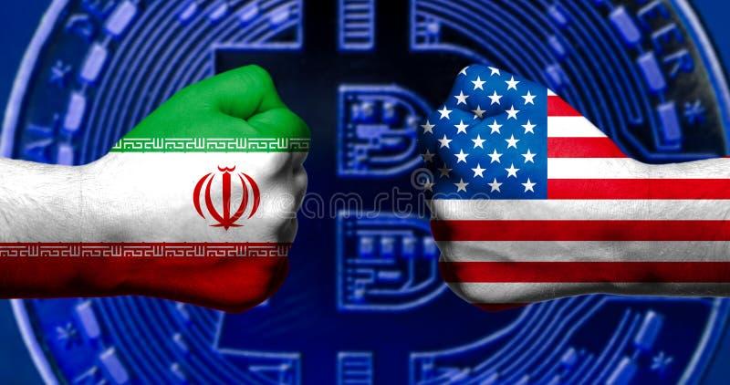 As bandeiras dos EUA e do Irã pintados em dois apertaram os punhos que enfrentam cada um imagem de stock royalty free
