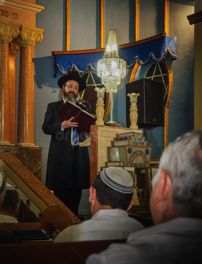 As the book says... Rabbi quotes from the book during his lecture to the congregation. Chief rabbi Atias, Petach-Tikva, Israel, April 22, 2015 stock images