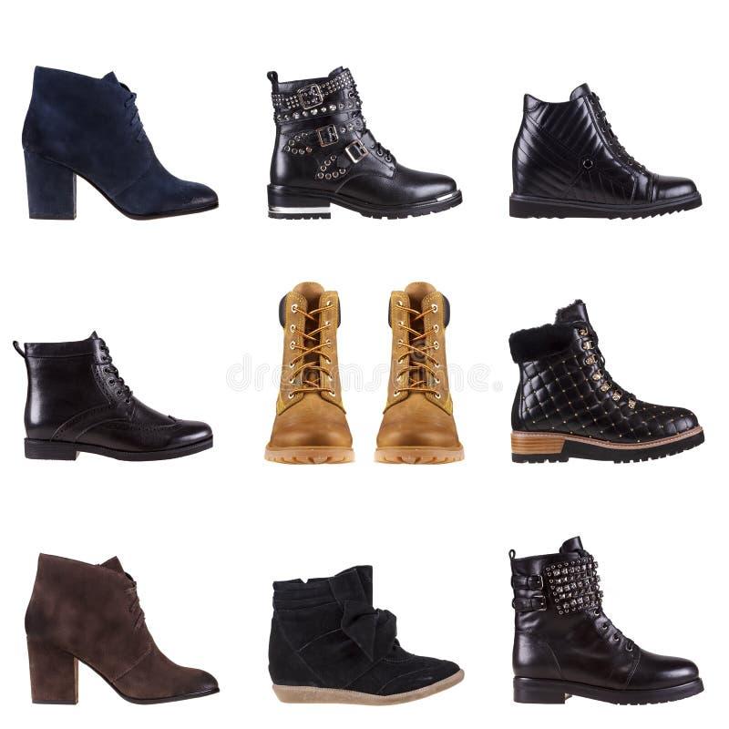 As botas modernas das mulheres elegantes e dos homens dispararam no estúdio foto de stock