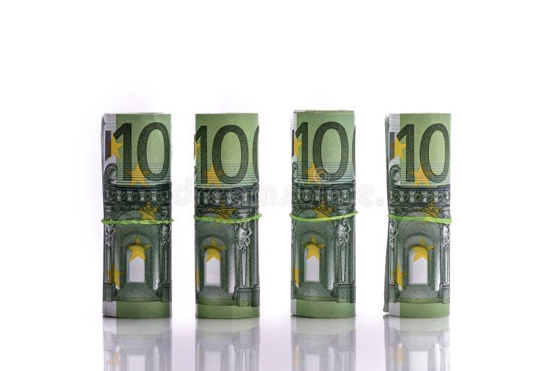 As cédulas do Euro rolaram acima em um fundo branco fotografia de stock royalty free